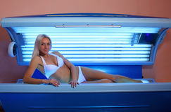 Woman sunbathing in the solarium Stock Photography
