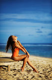 Woman sunbathing on a sunbed Stock Photos