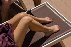 Woman on a sunbed while cruising. By the sea Royalty Free Stock Photography