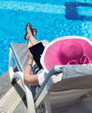 Woman on sunbed Stock Image