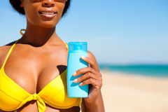 Woman with suncream at the beach Royalty Free Stock Image