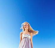 Woman in  sundress Stock Images