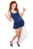 Woman in sundress dances and showing ok Royalty Free Stock Image