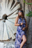 Woman in a sundress at the stone wall Royalty Free Stock Photo