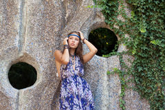 Woman in a sundress at the stone wall Stock Image