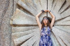 Woman in a sundress at the stone wall Royalty Free Stock Images