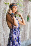 Woman in a sundress at the stone wall Royalty Free Stock Photos