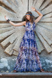 Woman in a sundress at the stone wall Stock Photography
