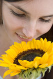 Woman with sunflower Royalty Free Stock Image