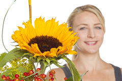 Woman with sunflower bouquet Royalty Free Stock Photos