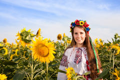 Woman at sunflower field Royalty Free Stock Image