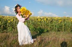 Woman in sunflower field Stock Photo
