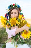 Woman in sunflower field Stock Image