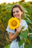 Woman in sunflower field Royalty Free Stock Images
