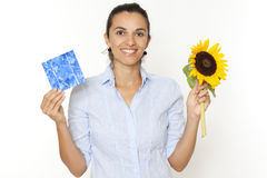 Woman with sunflower and solar cell Royalty Free Stock Photography