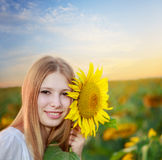 Woman with sunflower Stock Photos