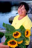 Woman sunflowers stock photography