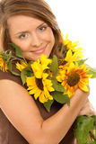 Woman with sunflowers. Portrait of young beauty woman holding sunflowers Royalty Free Stock Image