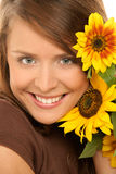 Woman with sunflowers. Portrait of young beauty woman holding sunflowers Royalty Free Stock Photo