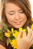 Woman with sunflowers. Portrait of young beauty woman holding sunflowers Stock Photos