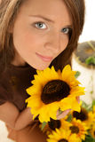 Woman with sunflowers Stock Photos