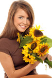 Woman with sunflowers. Portrait of young beauty woman with sunflowers isolated on white bacakground Royalty Free Stock Image