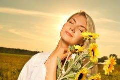 Woman with a sunflowers royalty free stock photography