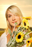 Woman with a sunflowers Royalty Free Stock Photo
