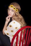 Woman sunflowers looking sitting Royalty Free Stock Image