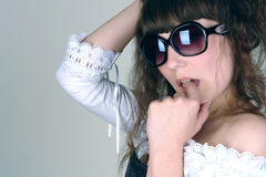 Woman in sunglass Stock Images