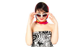 Woman in sunglasses. And motley dress looking Stock Photo
