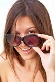 Woman in sunglasses Stock Images