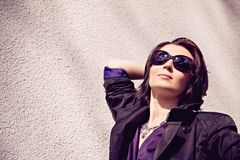 Woman in sunglasses basking in the gentle sun Stock Images