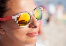 Woman In Sunglasses With Beach Reflection Stock Image