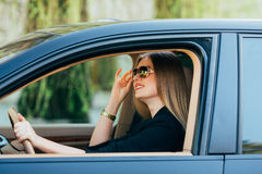 woman in sunglasses behind the wheel Royalty Free Stock Photos