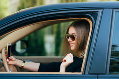 woman in sunglasses behind the wheel Stock Photos
