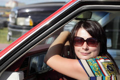 Woman with sunglasses in car Stock Photo