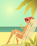 Woman in sunglasses in the chear on the beach. Royalty Free Stock Photos