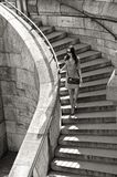 Woman in sunglasses and dress walking down stairs Royalty Free Stock Image