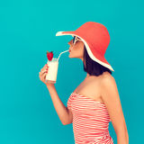 Woman with sunglasses drinking a cocktail Stock Photos