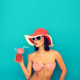 woman with sunglasses drinking a cocktail Stock Photo