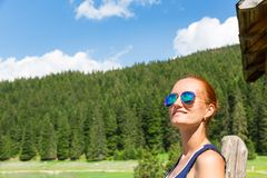 Woman with sunglasses in forest Stock Photos