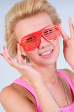 Woman in sunglasses in the form jalousie Stock Photo