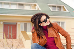 Woman in Sunglasses with Hand Behind Her Head Stock Image