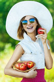 Woman sunglasses hat apples Royalty Free Stock Photos