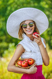 Woman sunglasses hat apples Royalty Free Stock Images
