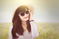 Woman with sunglasses and hat in nature Stock Photos