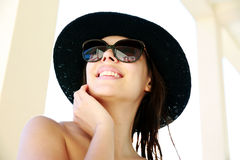 Woman in sunglasses and hat Stock Image