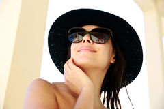 Woman in sunglasses and hat Stock Images