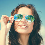 Woman in sunglasses Stock Image